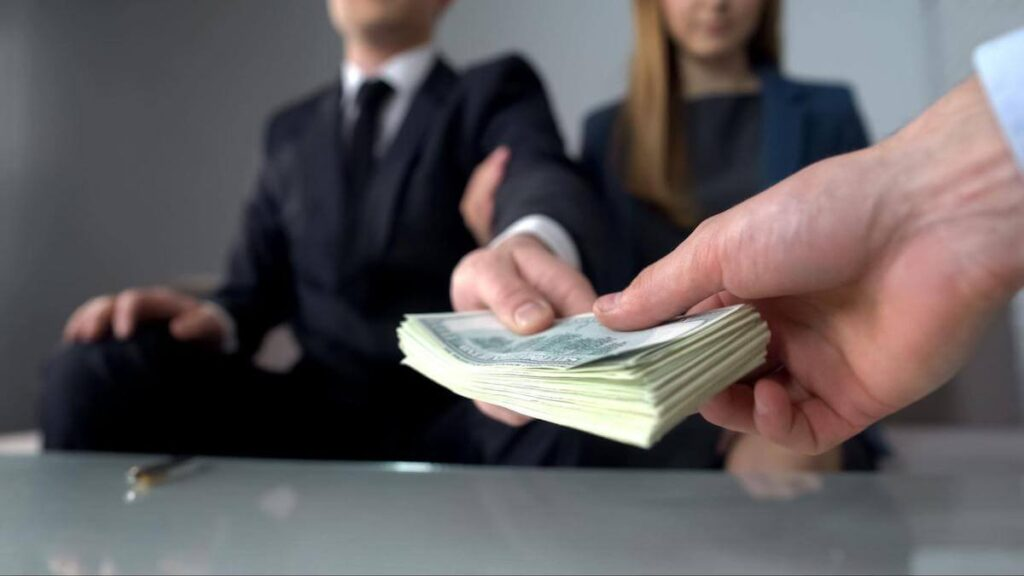 timeshare scams: person handing another person money