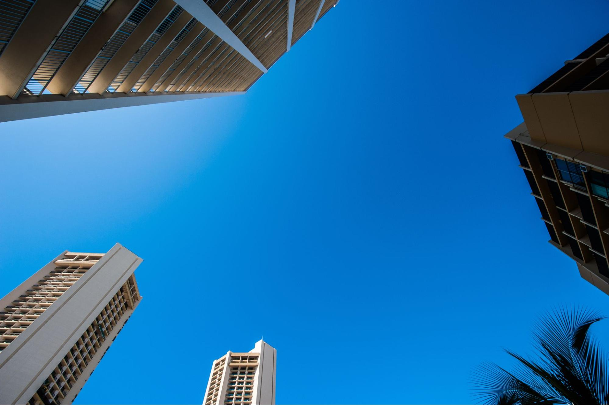 how do timeshares work: Photo of the sky and buildings taken from the ground
