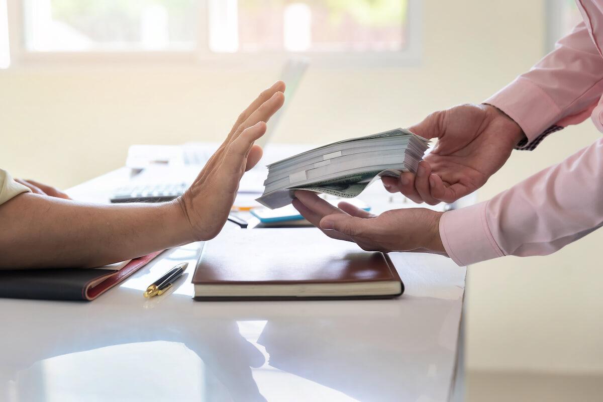 Person refusing a bribe