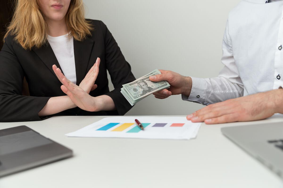Woman refusing cash